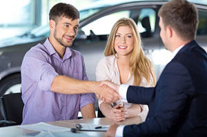 Couple buying car from auto advisor.