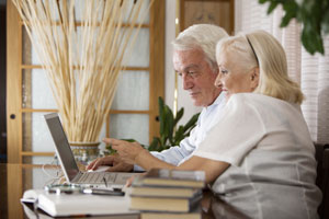 An older couple managing their Individual Retirement Account online